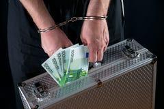 Man handcuffed for his crimes. Studio shoot Royalty Free Stock Photos