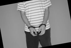 Man with handcuffs. Arrested man with hundcuffs - black-and-white Royalty Free Stock Image