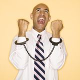Man in handcuffs. African American man wearing handcuffs and screaming Royalty Free Stock Photography