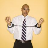 Man in handcuffs. African American man wearing handcuffs Stock Image