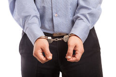 Man in handcuffs arrested, isolated Stock Images
