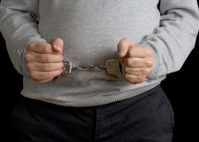 Man in handcuffs on black Stock Image