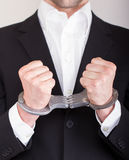 Man with handcuffs, business suit Royalty Free Stock Photo
