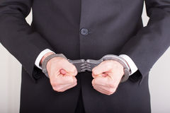 Man with handcuffs, business suit Stock Image