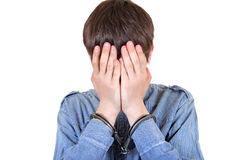 Man in Handcuffs Hide his Face Royalty Free Stock Photos