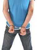 Man with handcuffs on his back Stock Photos