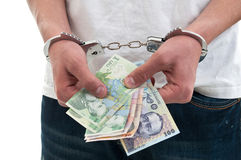 Man in handcuffs is holding money Stock Images
