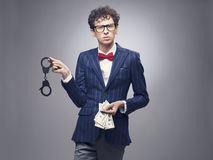 Man with handcuffs and money royalty free stock photo