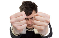 Man in handcuffs. The man in handcuffs shakes fists Stock Photos