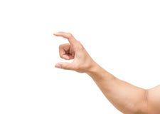 Man handen som mäter osynliga objekt på vit bakgrund, inkludera den snabba banan fotografering för bildbyråer