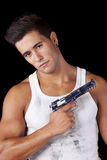 Man with a handgun Royalty Free Stock Photography