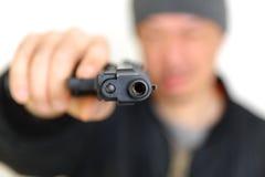 Man with a handgun Stock Image