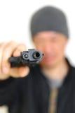Man with a handgun Stock Photography