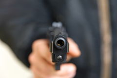 Man with a handgun. Concept shot of crime and justice Royalty Free Stock Photos