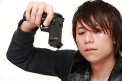 Man with a handgun Stock Photos