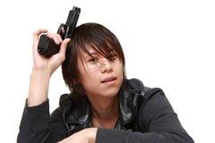 Man with a handgun Stock Images