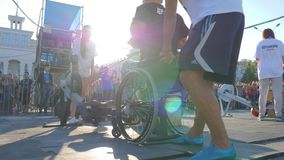Man handicapped on wheel chair is engaged on training apparatus in sports competition in bright natural light. Kherson, Ukraine 24 August 2017: man handicapped stock video
