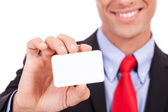 Man handing a blank business card Royalty Free Stock Image