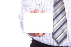 Man handing a blank business card Royalty Free Stock Photos
