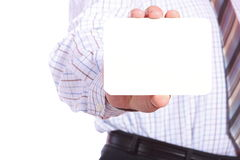 Man handing a blank business card Stock Image