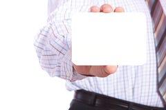 Man handing a blank business card Stock Image