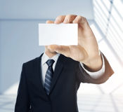 Man handing a blank business card Royalty Free Stock Photography