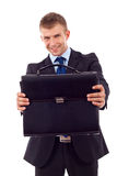 Man handing a brief case Stock Images