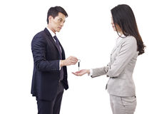 Man handing car key to woman Royalty Free Stock Photo