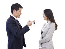 Man handing car key to woman Royalty Free Stock Images