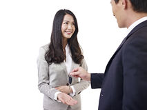 Man handing car key to woman Stock Images