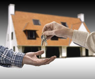 Man is handing a house key Royalty Free Stock Images