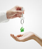 Man is handing a house key to a woman Royalty Free Stock Photo
