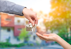 Man is handing a house key to a woman. Real estate concepts. Stock Photo