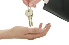 Handover of house keys Stock Photo