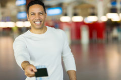 Man handing over air ticket Royalty Free Stock Images