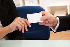 Man handing over a business card Royalty Free Stock Photography