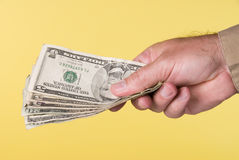 Man handing over cash Stock Photo