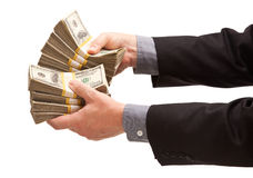 Man Handing Over Hundreds of Dollars. Isolated on a White Background Stock Photo