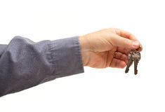 Man Handing Over the Keys. Isolated on a White Background Stock Image