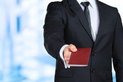 Man handing passport. Traveling business man handing passport Stock Photography