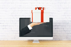 Man handing present Stock Photo