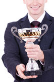Man handing a trophy ove Stock Image