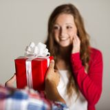 Man handing woman gift Royalty Free Stock Images