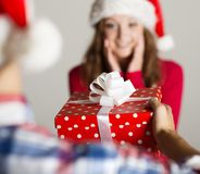 Man handing woman gift Stock Photo