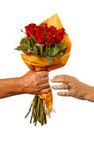 A man handing a women red roses Stock Photo