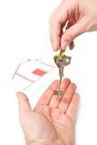 Man handing a women a set of keys Royalty Free Stock Image