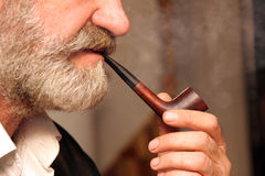 Man handle tobacco pipe. Details man handle a tobacco pipe stock photography