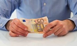 Man handling money. Royalty Free Stock Images