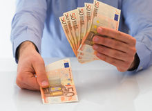 Man handling money. Stock Images