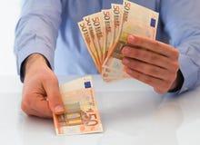 Man handling money. Close up of man hands handling money stock images